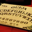 """MENTION THE USE of a Ouija board to a paranormal research group these days and you'll get a lot of head shaking and statements about """"opening portals"""" and """"demonic entities"""". Mention it to religious fundamentalists and you'll practically see them shudder and back away on shaky legs, as if the […]"""