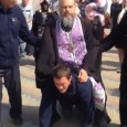 "A plump orthodox priest has been caught on camera riding a man like a donkey in a bizarre exorcism ritual. The 100kg priest threatens to ride the distraught man ""all the way to Jerusalem""."